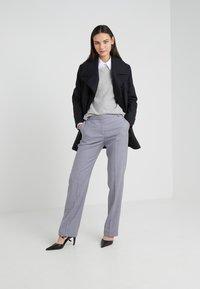 Tiger of Sweden - YULIA  - Spodnie materiałowe - soft lavender - 1