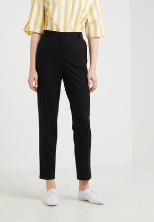 BLOSSOM - Pantalones - black