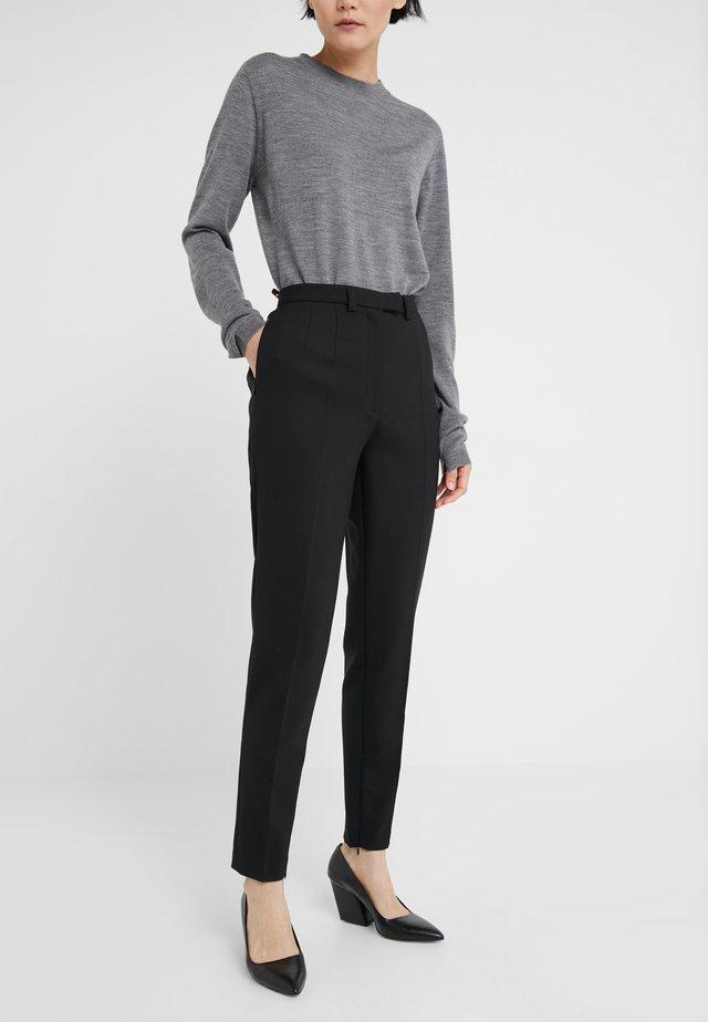 BERGENIA - Trousers - black