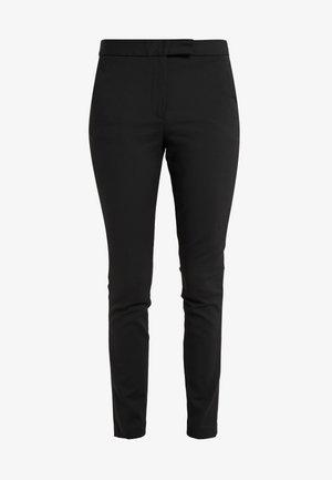 TAIKA - Trousers - black