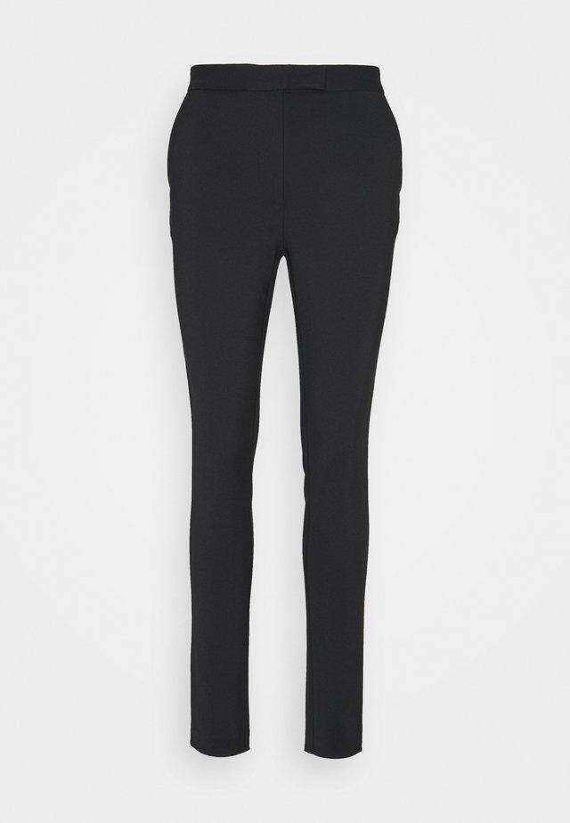 TAIKA - Spodnie materiałowe - black
