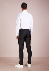 Tiger of Sweden - TERRISS TUXEDO PANTS - Suit trousers - black - 2