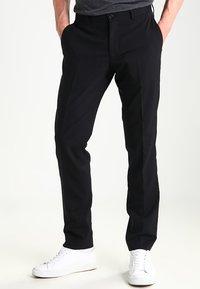 Tiger of Sweden - HERRIS - Pantaloni eleganti - black - 0