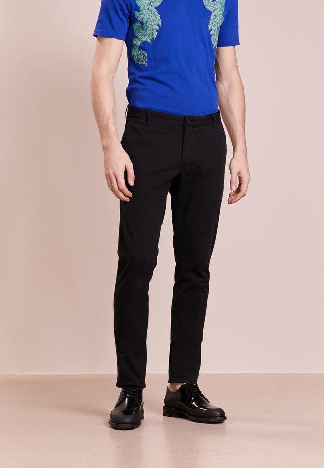 TRANSIT - Trousers - black