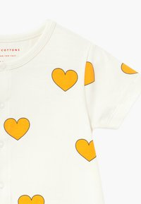 TINYCOTTONS - HEARTS ON PIECE - Jumpsuit - off-white/yellow - 4