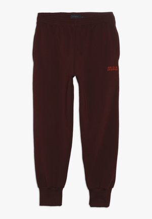 LUCKYWOOD SIGN  - Tracksuit bottoms - aubergine/red