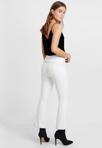 Tiger Mist - AVA PANTS - Bootcut jeans - white - 2