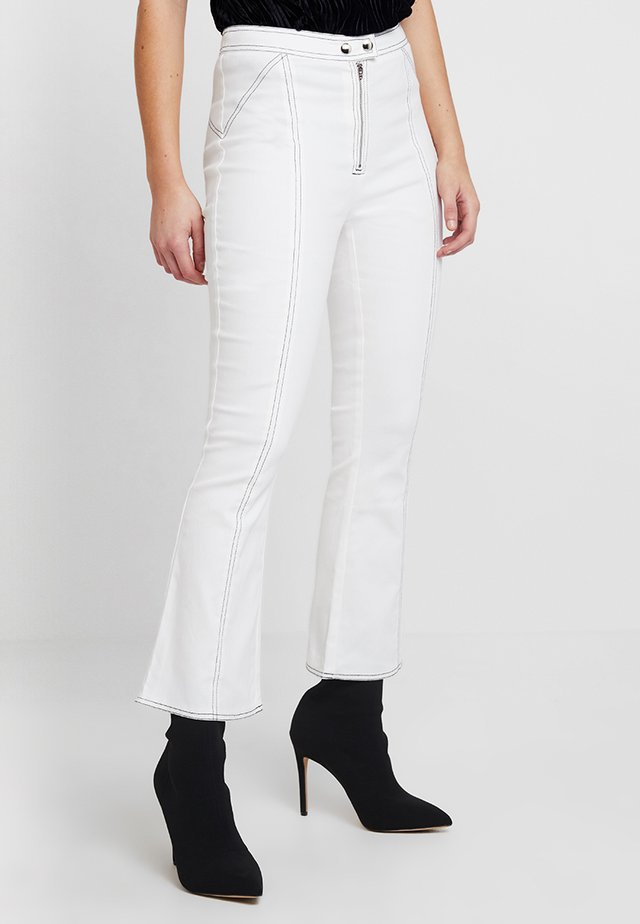 AVA PANTS - Bootcut jeans - white
