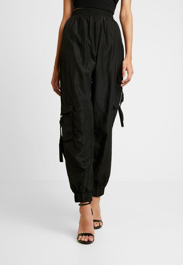 FLOSS PANT - Kalhoty - black