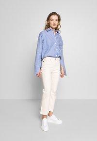 Tiger of Sweden Jeans - AZE - Flared Jeans - ecru denim - 1