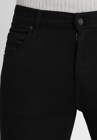 Tiger of Sweden Jeans - IGGY - Jeans relaxed fit - black denim - 4