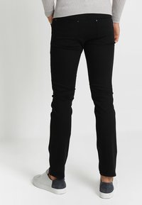 Tiger of Sweden Jeans - IGGY - Jeans relaxed fit - black denim - 2