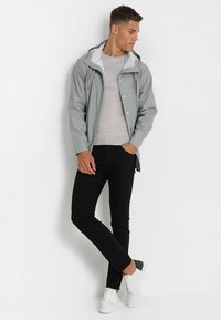 Tiger of Sweden Jeans - IGGY - Jeans relaxed fit - black denim - 1