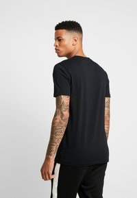 Tiger of Sweden Jeans - FLEEK - T-shirt med print - black - 2