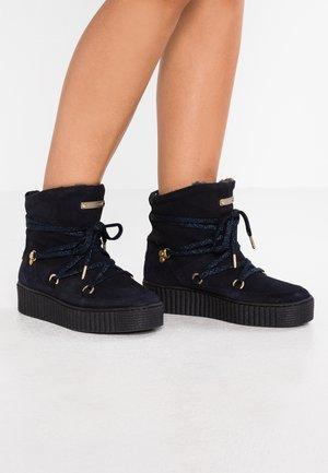 COZY WARMLINED - Platform ankle boots - blue