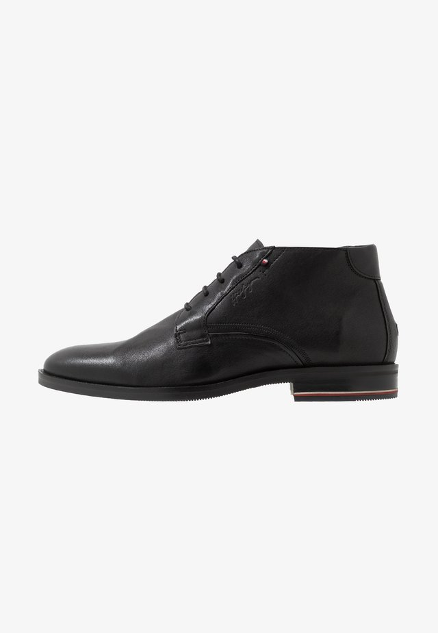 SIGNATURE BOOT - Lace-up ankle boots - black