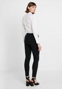 Tommy Hilfiger - HERITAGE FIT PANTS - Pantalon classique - masters black - 2