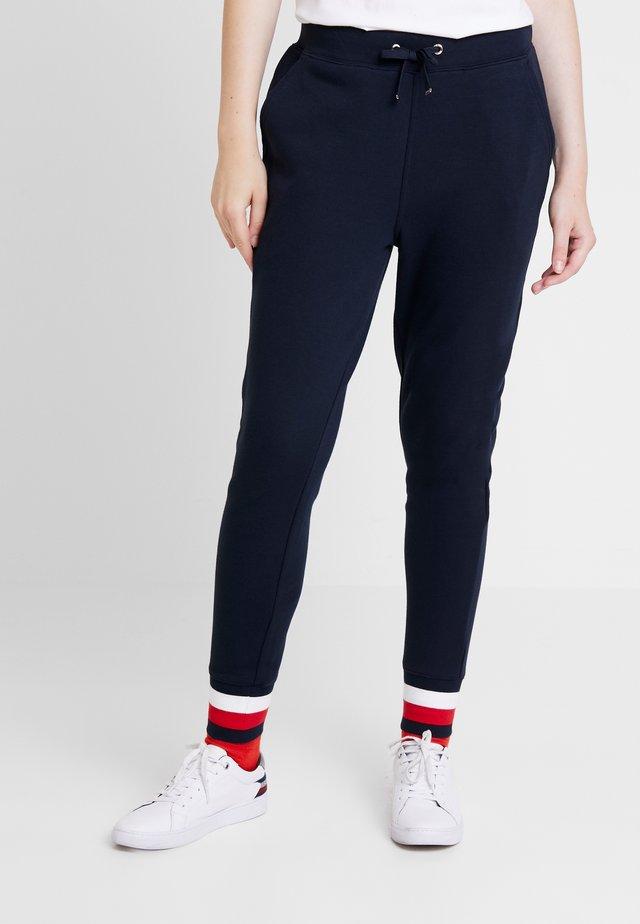 HERITAGE PANTS - Spodnie treningowe - midnight