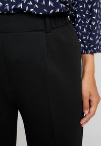 Tommy Hilfiger - DION PULL ON PANT - Pantaloni sportivi - black - 7