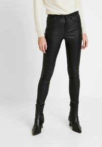 Tommy Hilfiger - STRETCH PANTS - Trousers - black - 0