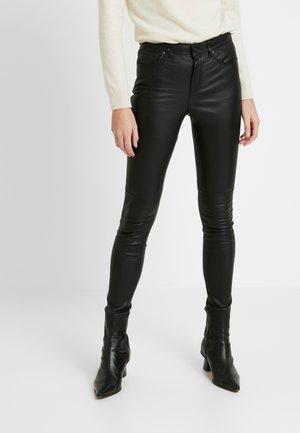 STRETCH PANTS - Trousers - black