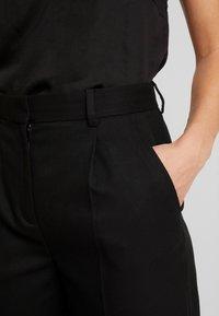 Tommy Hilfiger - ESSENTIAL FLANNEL PANT - Pantalon classique - black - 4