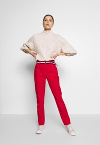 Tommy Hilfiger - SLIM FIT CHINO - Chinos - primary red - 1