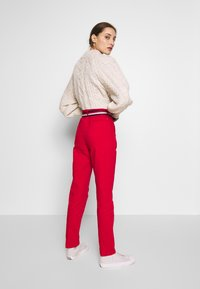 Tommy Hilfiger - SLIM FIT CHINO - Chinos - primary red - 2