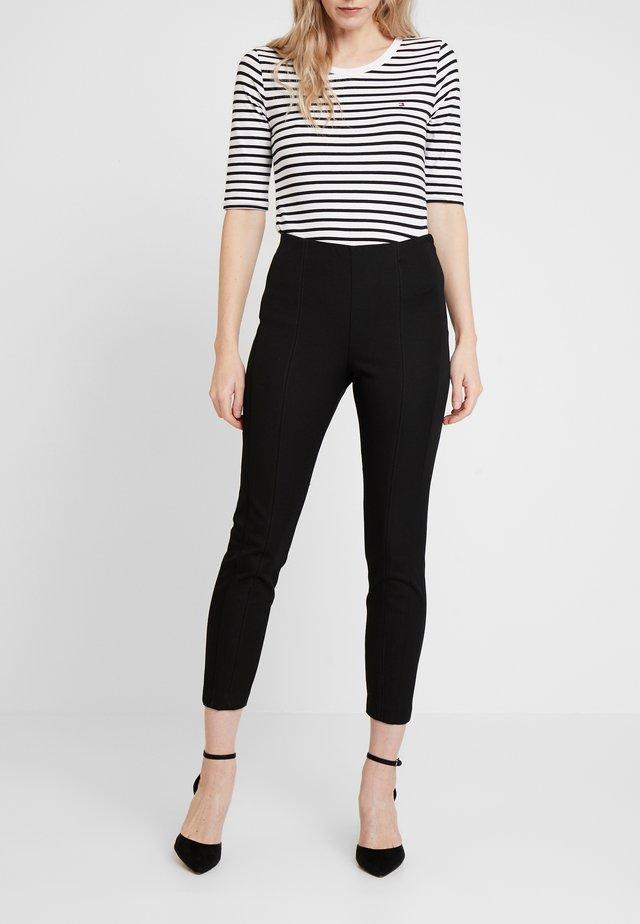 FLEUR ANKLE - Spodnie materiałowe - black