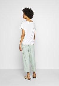 Tommy Hilfiger - TAPERED PANT - Pantalon classique - sea mist mint - 2