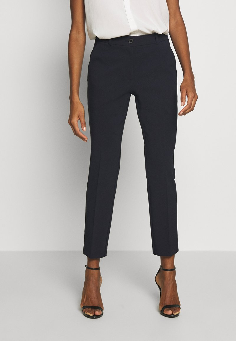 Tommy Hilfiger - BISTRETCH POLY SLIM  - Trousers - desert sky