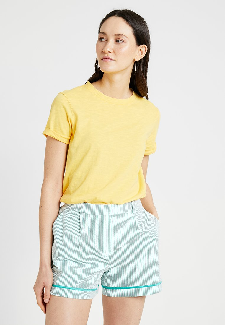 Tommy Hilfiger - TEE CAP - Print T-shirt - yellow