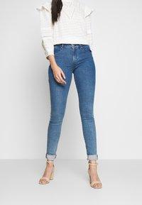 Tommy Hilfiger - COMO WILO - Jeans Skinny Fit - blue denim - 1