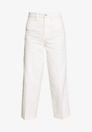 BELL BOTTOM - Flared jeans - ivory