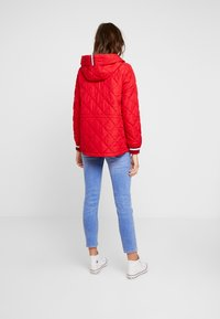 Tommy Hilfiger - IVAN QUILTED JACKET - Lett jakke - red - 2
