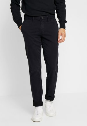 DENTON FLEX - Pantalones chinos - black