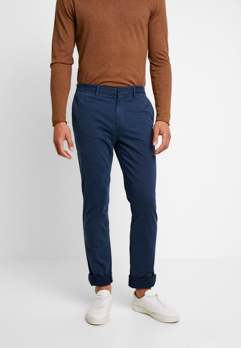 Tommy Hilfiger - DENTON FLEX - Pantalones chinos - blue