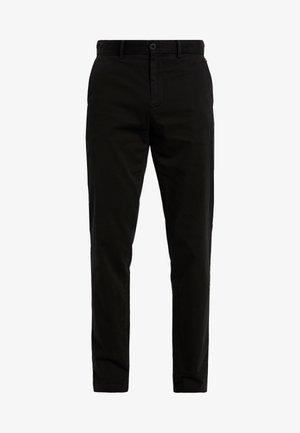 DENTON - Trousers - black