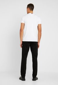 Tommy Hilfiger - DENTON - Trousers - black - 2
