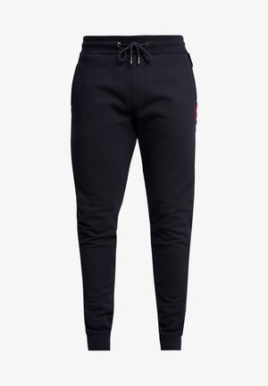 FLOCKED  - Pantalon de survêtement - blue