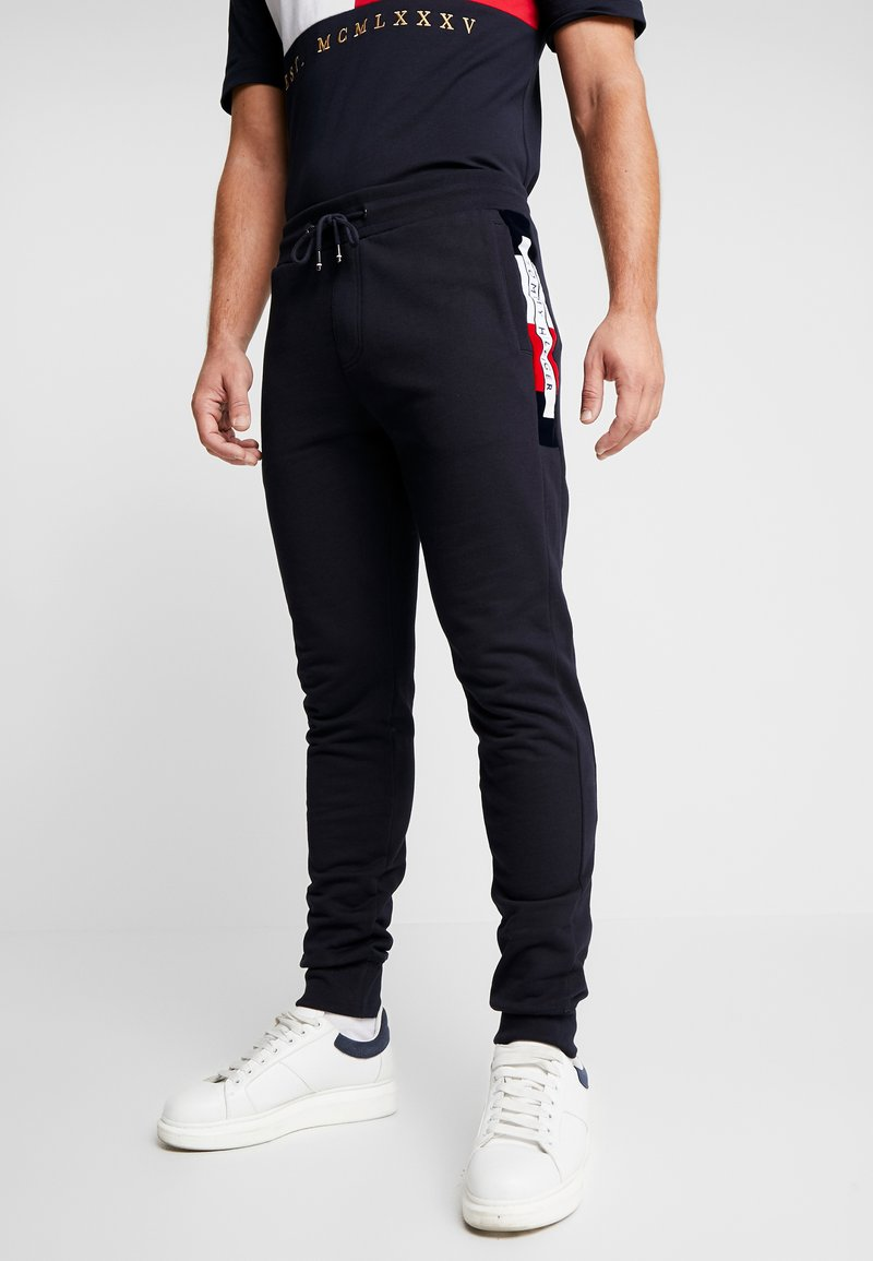 Tommy Hilfiger - FLOCKED  - Trainingsbroek - blue