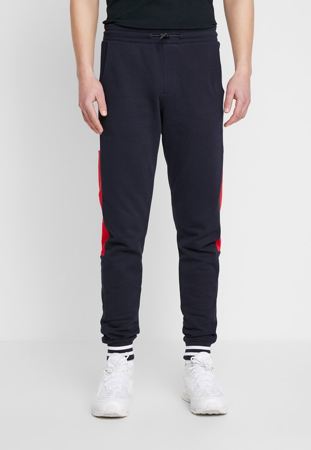 COLORBLOCKED  - Tracksuit bottoms - blue