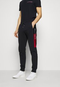 Tommy Hilfiger - INTARSIA - Tracksuit bottoms - blue - 0