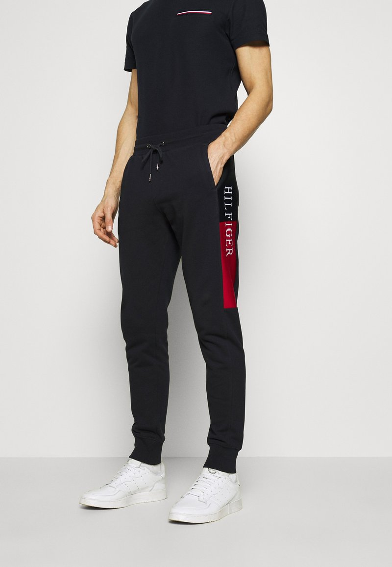 Tommy Hilfiger - INTARSIA - Tracksuit bottoms - blue