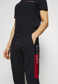 Tommy Hilfiger - INTARSIA - Tracksuit bottoms - blue - 3