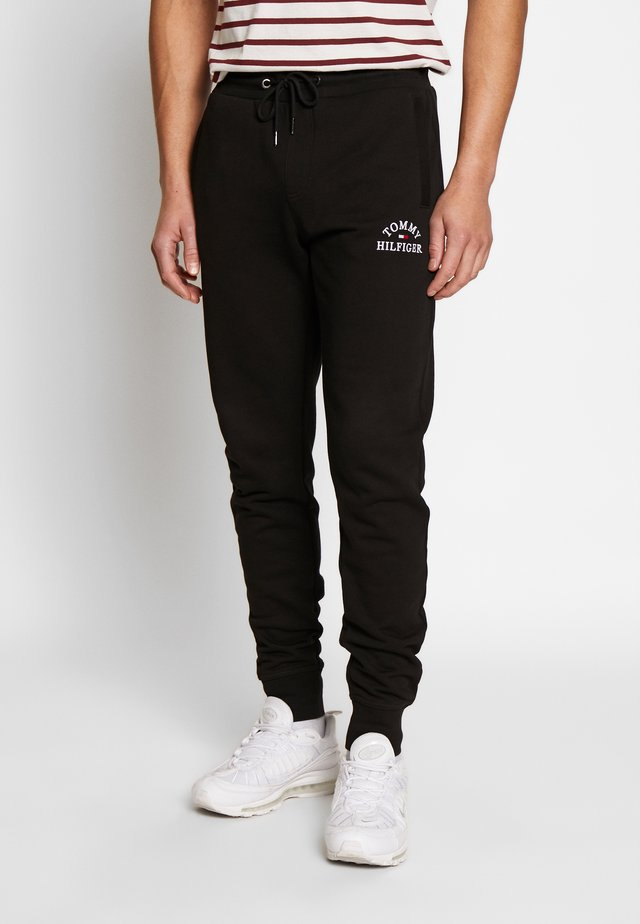 BASIC EMBROIDERED PANTS - Tracksuit bottoms - black