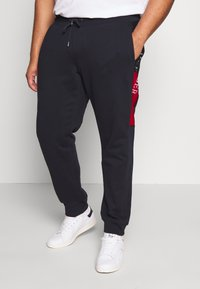Tommy Hilfiger - INTARSIA - Trainingsbroek - blue - 0