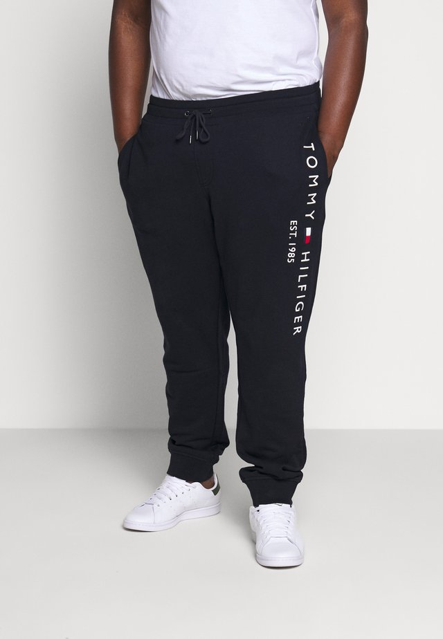 BASIC BRANDED - Tracksuit bottoms - blue