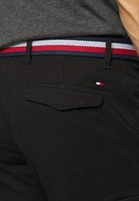 Tommy Hilfiger - JOHN CARGO - Cargo trousers - black - 5