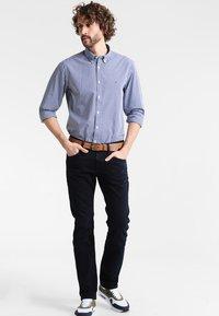 Tommy Hilfiger - DENTON - Straight leg jeans - blue black - 1